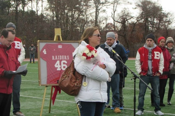 Jan Anderson graciously thanks Barnstable High School, the Barnstable Quarterback Club, and others for retiring her son's jersey on Thanksgiving Day.