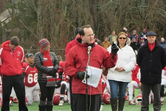 State Representative Brian Mannal speaks in honor of Kevin Houston. As children, the two men were teammates with the Barnstable Silver Bullets.