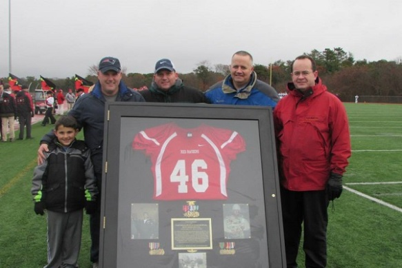 Joe Kennedy, Jasen O'Neil, Justin Cazeault and Brian Mannal stand beside an amazing shadow box created by  Joe Kennedy to house Kevin Houston's retired jersey.
