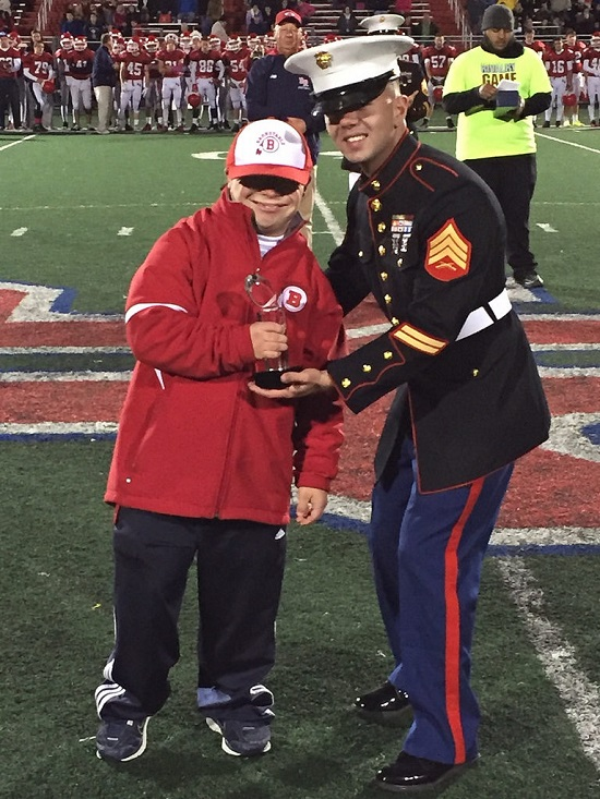 Here Coach Bentivegna is receiving his Great American Rivalry 2015 Hall of Fame trophy from the United States Marines. Photo Credit: United States Marines