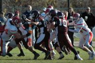 #44 Chris Weber and #54 Sean Ford converge on Falmouth QB Nick Couhig