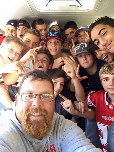 Coach Kris Dumas and the Freshman team celebrate on their ride home after defeating the Marshfield High freshmen on October 31st! Selfie Credit: Coach Dumas